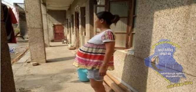 Chinese woman carrying her baby 17 months